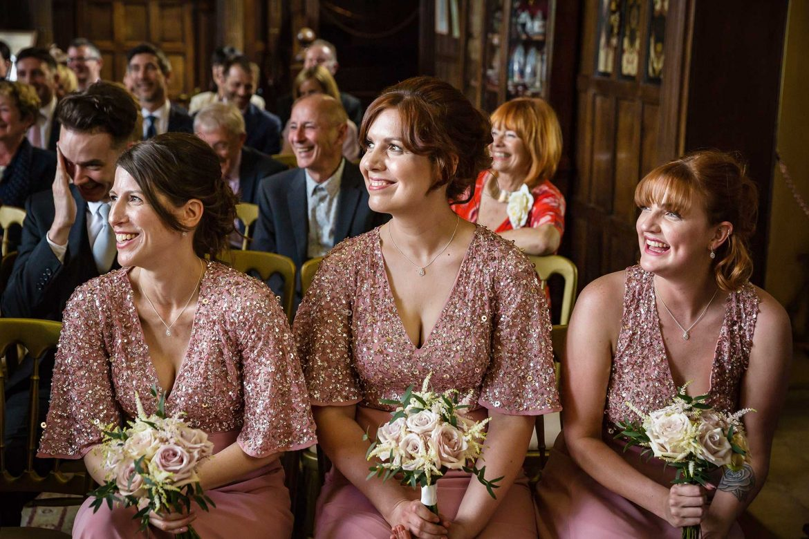 bridesmaids watch and smile