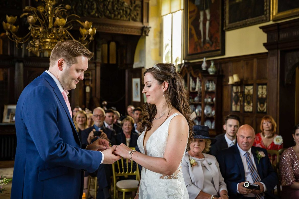 exchange of wedding rings at Loseley Park