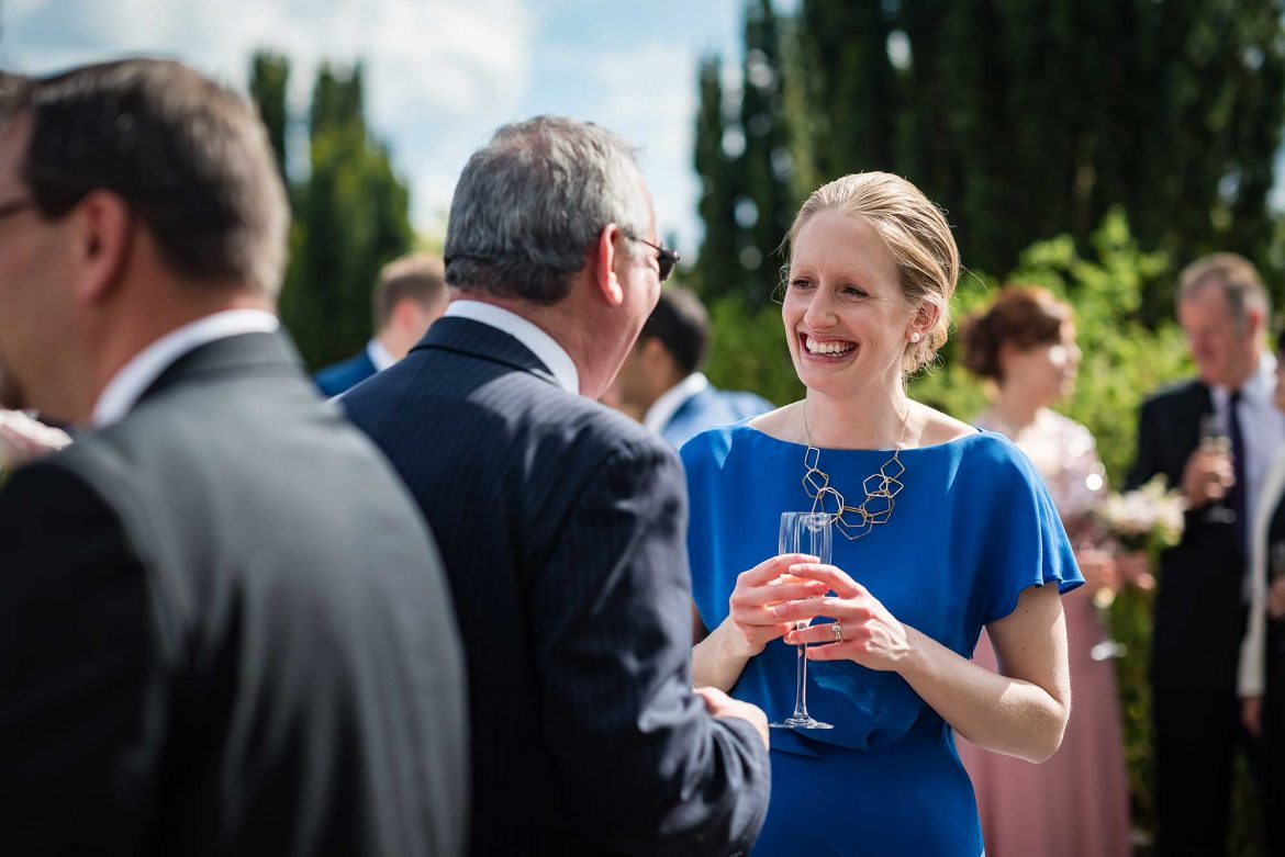 Woman laughs at Loseley Park Wedding