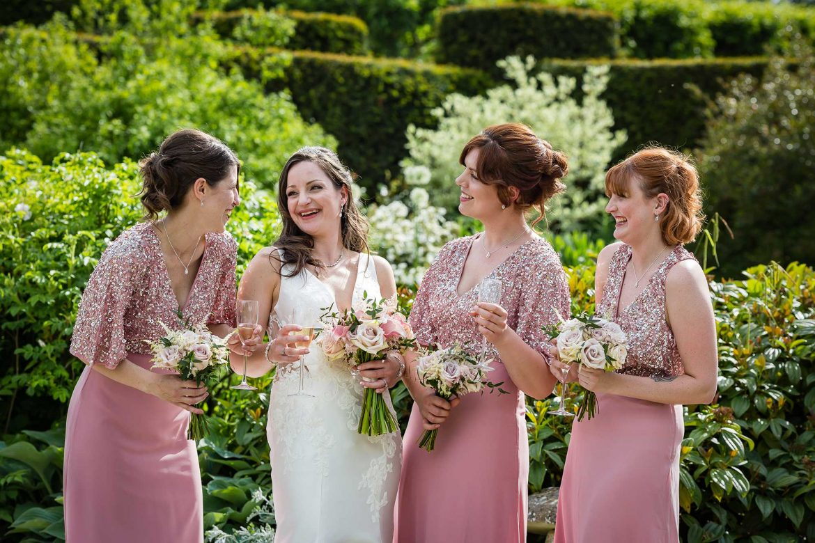 bride at Loseley Park Wedding with bridesmaids