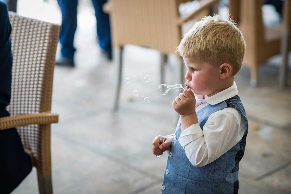 boy blows bubbles