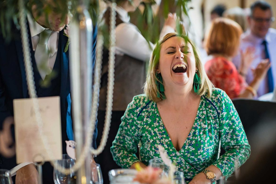 woman laughing at wedding
